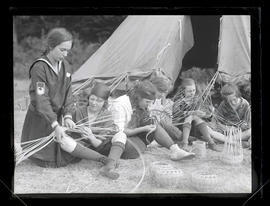Camp Fire Girls weaving baskets at camp near Carver, Oregon