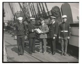 Major George E. Sandy presents U. S. history books for library of USS Constitution