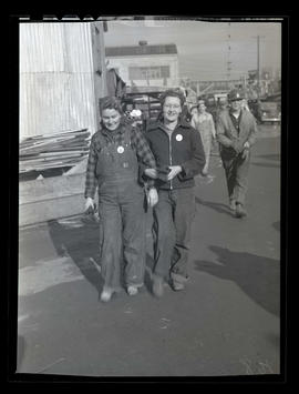 Workers walking at Albina Engine & Machine Works, Portland