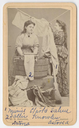 Two women washing laundry