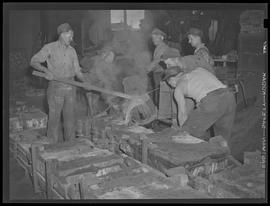 Pouring metal at Commercial Iron Works, Portland