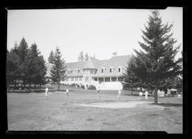 Golfers and clubhouse at Portland Golf Club