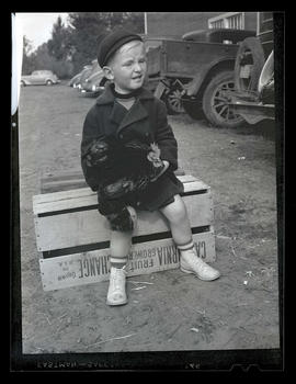 Unidentified boy holding chicken, probably at Pacific International Livestock Exposition