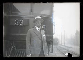 Judge Gary, standing in front of train car