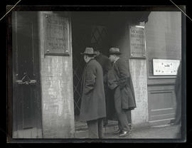 Customers looking through gated door of closed Morris Brothers bank in Portland