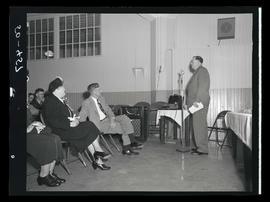 Man speaking to seated audience