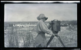 Irene Finley photographing pelicans and cormorants