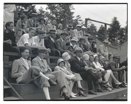 People seated in bleachers at unidentified event