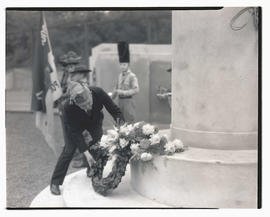 Unidentified man laying wreath at cenotaph during memorial service? at Multnomah Stadium, Portland