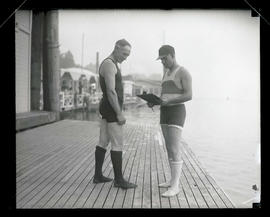 Two unidentified men on dock