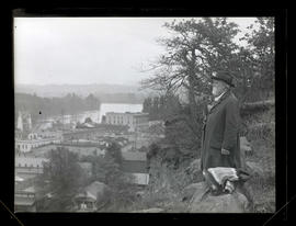 Unidentified man on bluff overlooking Oregon City, Oregon