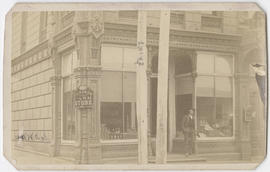 Unidentified man standing outside Packard's Cash Store, Portland, Oregon