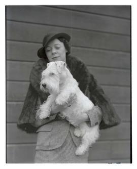 Unidentified woman holding dog, probably at Pacific International Livestock Exposition
