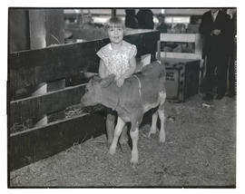 Girl posing with calf