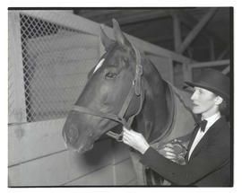 Woman with horse and prize ribbon