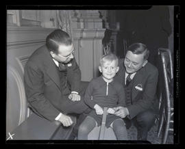 Joseph K. Carson with unidentified man and boy at Portland Breakfast Club Christmas party?