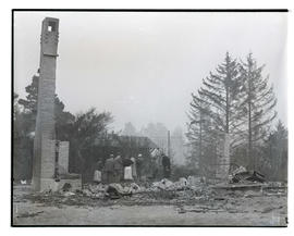 Mrs. O. W. Ransower and others looking at remains of home destroyed by wildfire in Bandon, Oregon