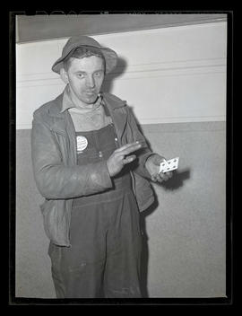 Clinton English? holding playing card with cigarette in the center, Albina Engine & Machine W...