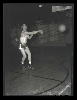 Morrie Helser, basketball player for Albina Hellships, passing ball