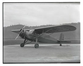Parked monoplane with number NC 13169