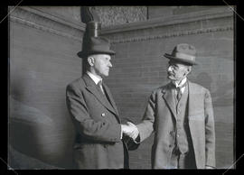 Vice President Calvin Coolidge and unidentified man shaking hands