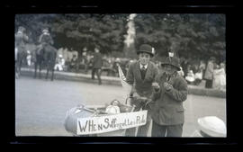 Costumed boys in parade? with baby carriage and 'When Suffragettes Rule' sign
