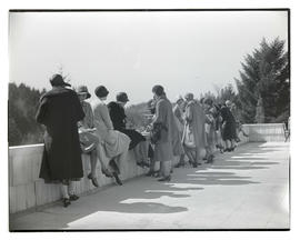 Group of unidentified women eating on balcony or terrace