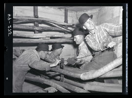 Group of men working on electrical utilities