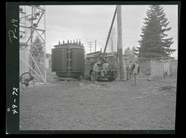 Men with truck and wooden utility pole