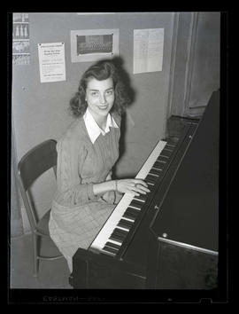 1942 Portland Rose Festival Princess Margaret Grasle, sitting at piano