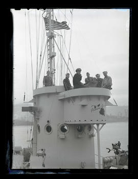 "Six men aboard ship with ""Portland Rose"" painted on pilot house"
