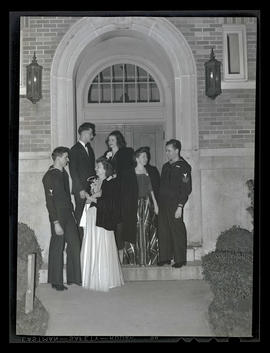 Students and their dates outside administration building at Marylhurst College dance, 1944?