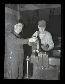 Workers cutting pipe, Albina Engine & Machine Works, Portland