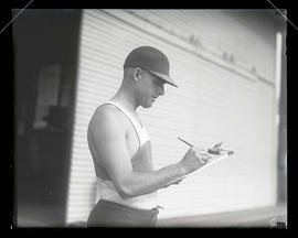 Unidentified man holding clipboard