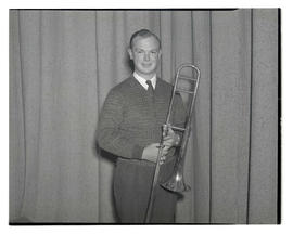 Young man holding trombone