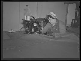 Worker sewing cloth at Oregon Shipbuilding Corporation, Portland