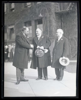 George L. Baker and two unidentified men at Union Station, Portland?