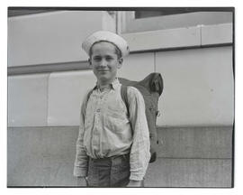 Unidentified boy carrying backpack, half-length portrait