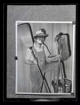 Composite photograph of person posing with mop and brooms, Albina Engine & Machine Works, Por...
