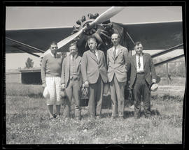 Tex Rankin, Judge Hall S. Lusk, and three unidentified men in front of airplane