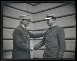 Portland Fire Chief Lee G. Holden and fire marshal Edward Grenfell shaking hands