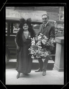 George L. Baker and unidentified woman, holding bouquet