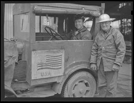 Workers with vehicle at Oregon Shipbuilding Corporation, Portland