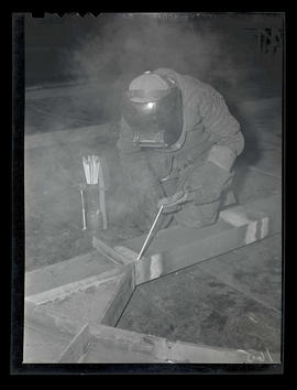Welder, probably Pat Mulligan, working at Albina Engine & Machine Works, Portland