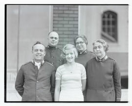 Young woman with four Salvation Army members