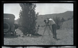 William L. Finley photographing Pete the dog