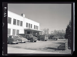 Building and parking lot with Portland General Electric trucks