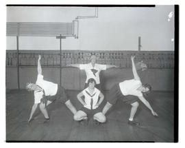 Four unidentified women holding calisthenics poses