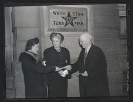 Three unidentified people outside White Star Tuna Fish