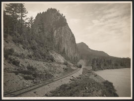 SP&S train passing Beacon Rock in Columbia River Gorge, Washington
